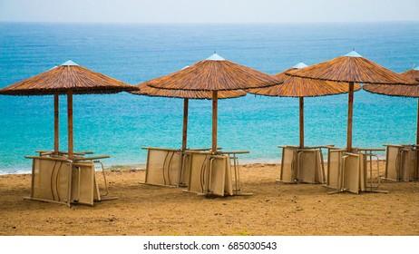 Reed beach umbrellas on the beach.