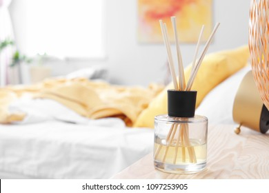 Reed freshener on table in bedroom