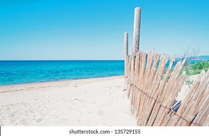 reed palisade in a Sardinia beach