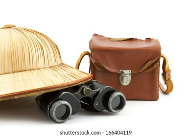reed safari hat, vintage camera and binoculars isolated on white