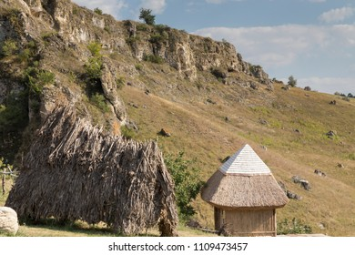 Reef deposit in th north Moldova. The small house is roofed from bulrush under the cliff rock.