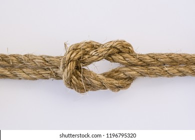 Reef knot in Sisal rope isolatedon white background.