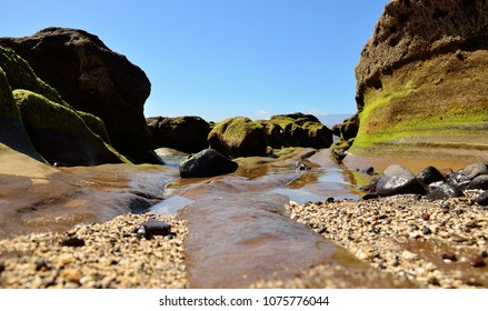 Reef at low tide and blue sky, The confital, coast of Gran canaria