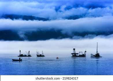 Reefnet Salmon Fishermen on a Foggy Day. Pacific salmon fishermen off of Lummi Island in the Puget Sound area of Washington State. Reefnetting is an old Indian method for catching salmon.