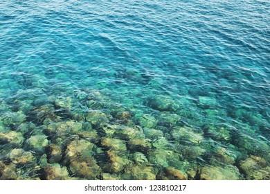 Reefs in transparent azure water