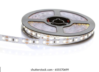 Reel of a diode strip with cold light on a white background