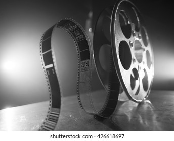 Reel of film on a black-white background