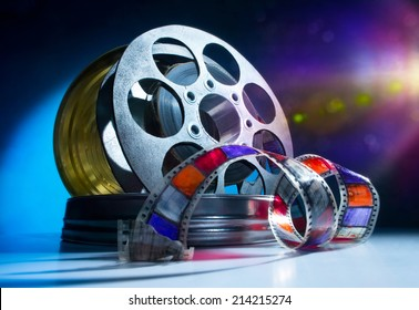 Reel of film on a color background