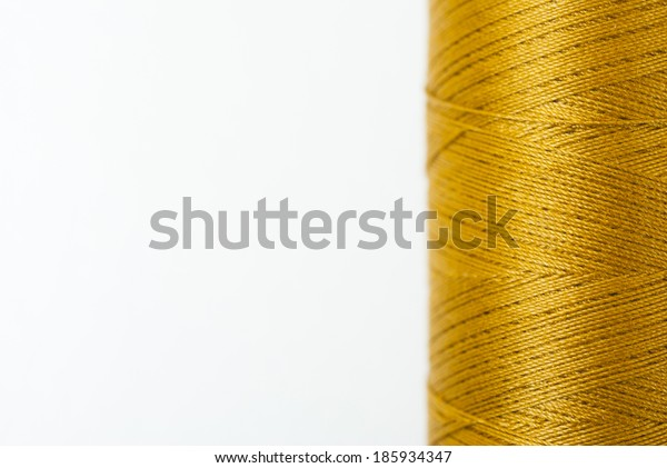 reel of thread on white, not isolated
