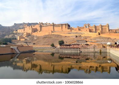 The reelection of Agra Fort spreads across a lake outside its walls.