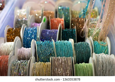 Reels with ribbons with rhinestones of different colors.