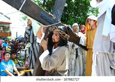 Reenactment of the death of Jesus Christ. April 18, 2014. Midtown Village Park, Cainta, Rizal, Philippines.