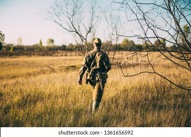 Re-enactor Dressed As World War II Russian Soviet Red Army Officer Soldier Walking Through Autumn Meadow. Soldier Of WWII WW2 Times.