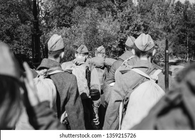 Re-enactors Dressed As World War II Russian Soviet Red Army Soldiers Marching Through Forest. Photo In Black And White Colors. Soldier Of WWII WW2 Times.