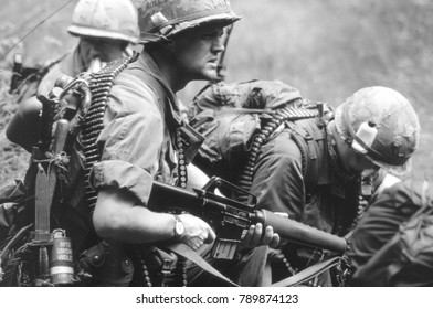 Re-enactors of the Vietnam War Society wear uniforms and equipment of US riflemen of the Vietnam War this image was taken in Ashdown Forest England in 2001