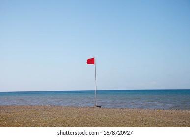 Ref flag warning on beach Spain