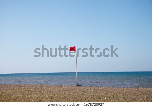 Ref flag warning on beach Spain
