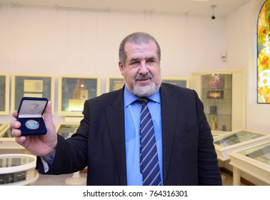 Refat Chubarov, the Chairman of the Mejlis of the Crimean Tatar People, presents to mass-media commemorative coin in honor of 100th anniversary of the first Qurultay. November 22, 2017. Kiev, Ukraine