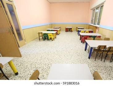 refectory of a school for children with small chairs and tables to eat lunch without people