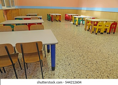 refectory tables and colored chairs in a nursery school