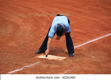 referee cleansing the base