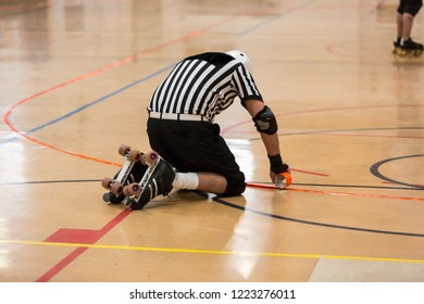 Referee fixing the tape on a roller derby ring