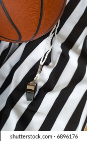 A referee jersy with a whistle and a basketball, basketball referee's equipment