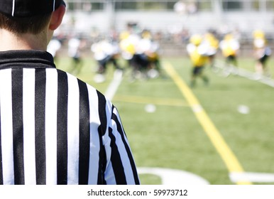 Referee on field during a football game.