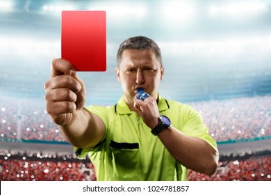 Referee showing the red card in the soccer stadium