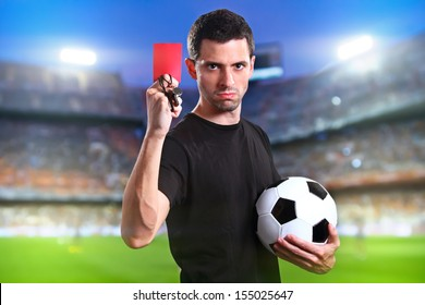Referee showing the red card in the soccer stadium.