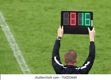 The referee shows the number display announcing the change of players during the soccer match
