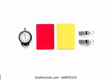 Referee tools. Yellow and red cards, stopwatch, whistle on white background top view copyspace