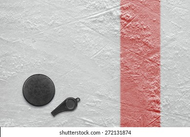 Referee whistle and washer on the hockey rink. Texture, background
