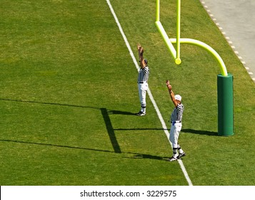 referees signaling a touchdown in football