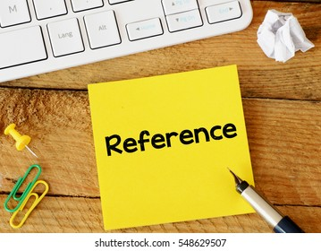 Reference/Reference sticker with marketing plan inscription over computer keyboard