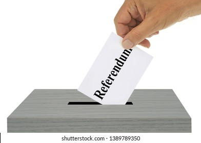 Referendum concept with someone putting a ballot in a ballot box