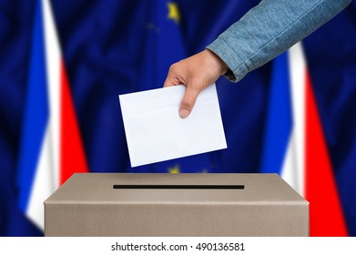Referendum in France. The hand of woman putting her vote in the ballot box. France and European Union flags on background. Frexit.