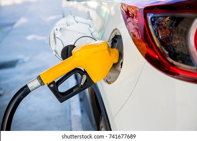 Refill and filling Oil Gas Fuel at station.Gas station - refueling.To fill the machine with fuel. Car fill with gasoline at a gas station. Gas station pump.