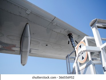 Refill fuel airplane.