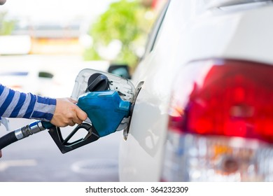 Refill fuel to a car at gas station