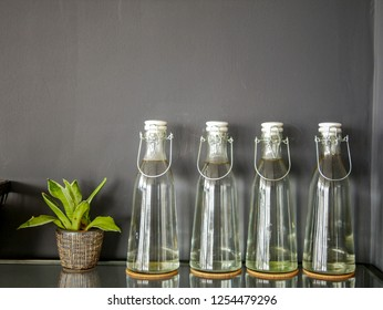 Refill glass bottles line on wall space for reduce plastic concept