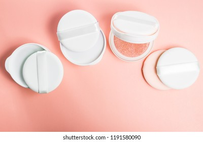 Refills of foundation and highlighter cushion on a pink background