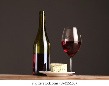 Refined still life of wine and cheese on wooden table