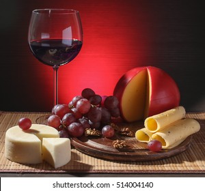 Refined still life of wine, cheese and grapes on wooden table on lightening background