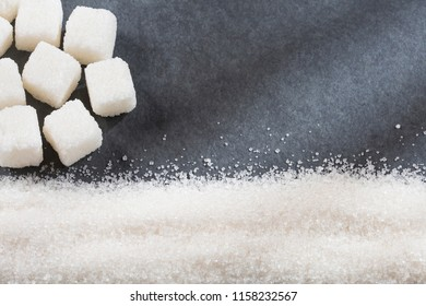 Refined white sugar powder and cubes. Top view