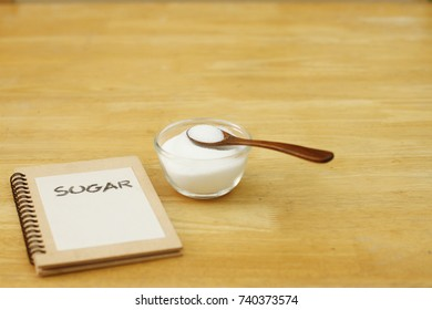 Refined White Sugar with Wood background