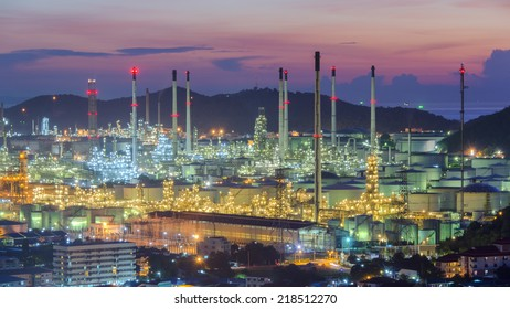 Refinery factory lights in evening twilight sky