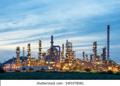Refinery and industrial natural gas tanks with the backdrop of the morning sky