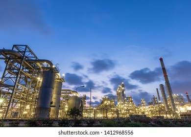 refinery industrial at twilight. storage tank.