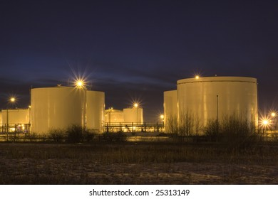 Refinery Oil Tank Reserves at Night